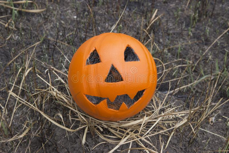 Jack lantern for Halloween of a basketball on scorched earth stock image