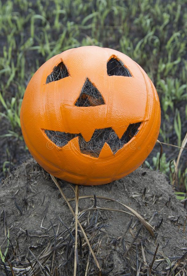 Jack lantern for Halloween of a basketball on scorched earth stock photo