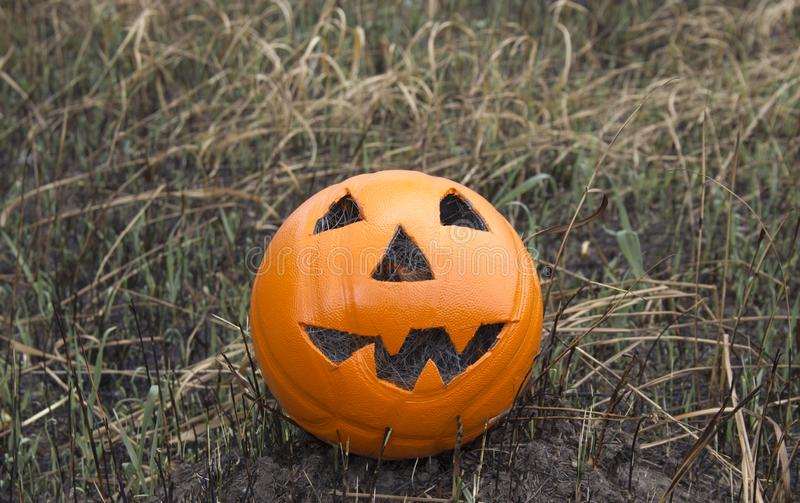Jack lantern for Halloween of a basketball on scorched earth royalty free stock image