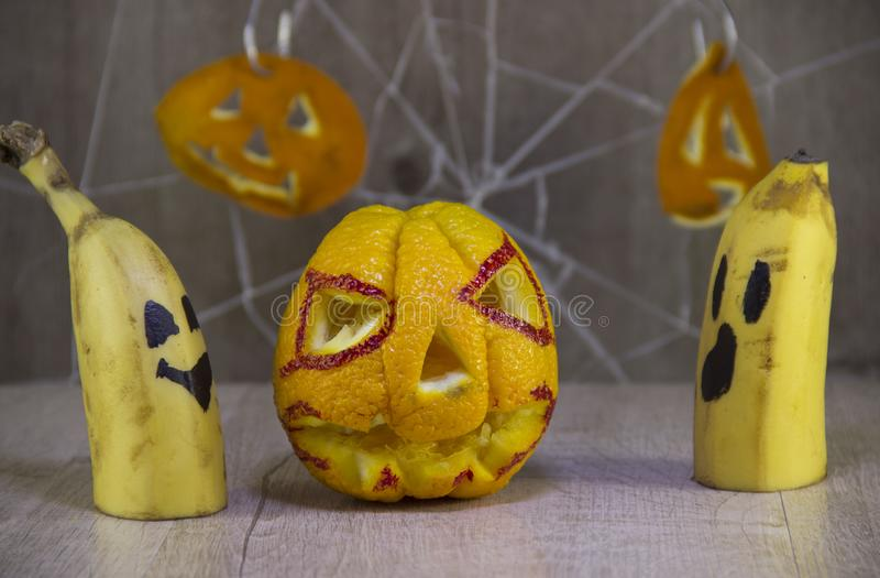 Jack lantern for Halloween of oranges on a wooden background with cobwebs stock photo
