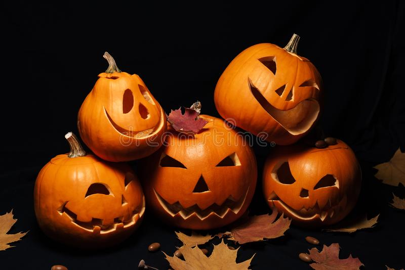 Jack lantern pumpkins for Halloween decoration and maple leaves with acorns stock photography