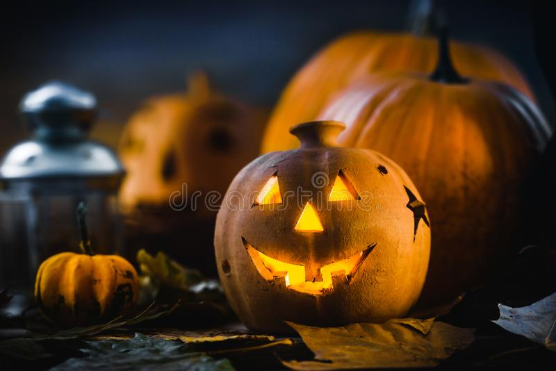Jack o Lantern - autumn Halloween holiday concept background. Spooky arrangement. Holiday greeting card stock images