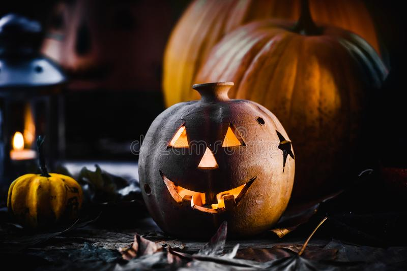 Jack o Lantern - autumn Halloween holiday concept background. Spooky arrangement. Holiday greeting card royalty free stock image