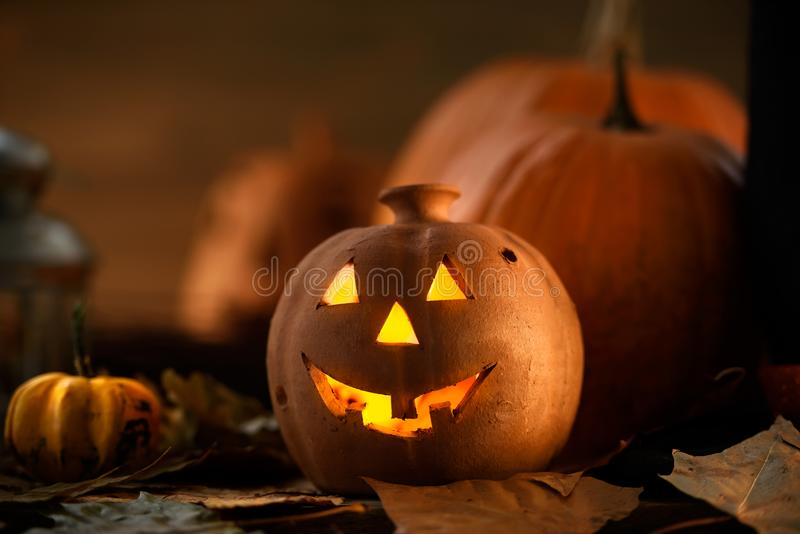 Jack o Lantern - autumn Halloween holiday concept background. Spooky arrangement. Holiday greeting card royalty free stock photography