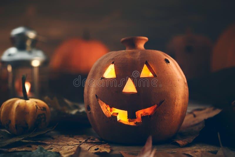 Jack o Lantern - autumn Halloween holiday concept background. Spooky arrangement. Holiday greeting card stock photos
