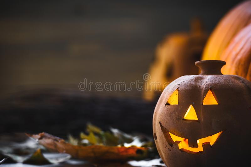 Jack o Lantern - autumn Halloween holiday concept background. Spooky arrangement. Holiday greeting card stock photography