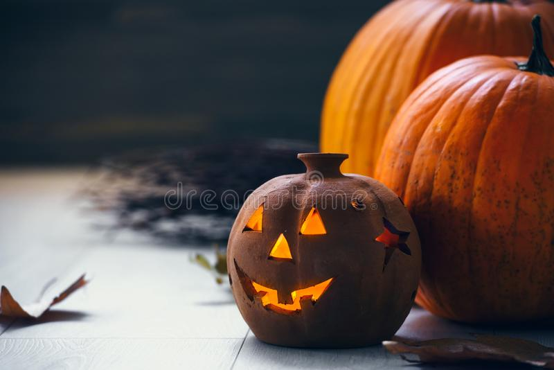 Jack o Lantern - autumn Halloween holiday concept background. Spooky arrangement. Holiday greeting card stock image
