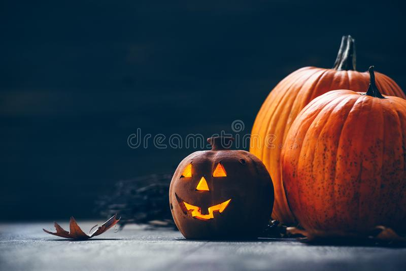 Jack o Lantern - autumn Halloween holiday concept background. Spooky arrangement. Holiday greeting card royalty free stock photos