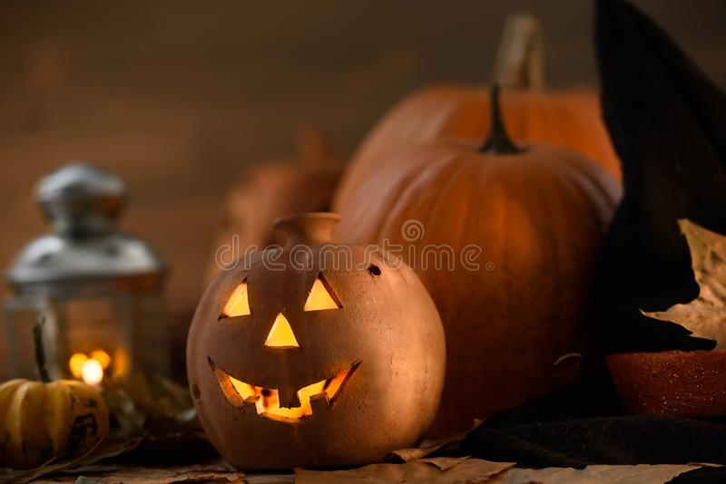 Jack o Lantern - autumn Halloween holiday concept background. Spooky arrangement. Holiday greeting card stock photo