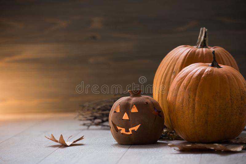 Jack o Lantern - autumn Halloween holiday concept background. Spooky arrangement. Holiday greeting card royalty free stock photo