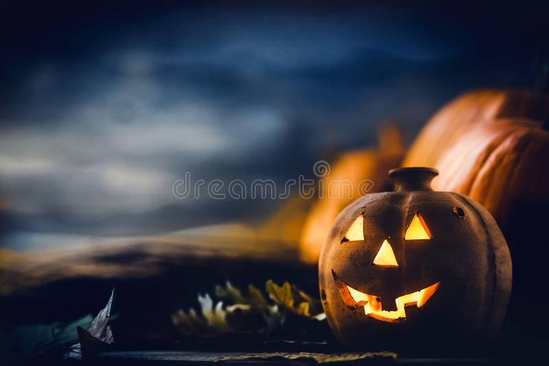 Jack o Lantern - autumn Halloween holiday concept background. Spooky arrangement. Holiday greeting card royalty free stock images