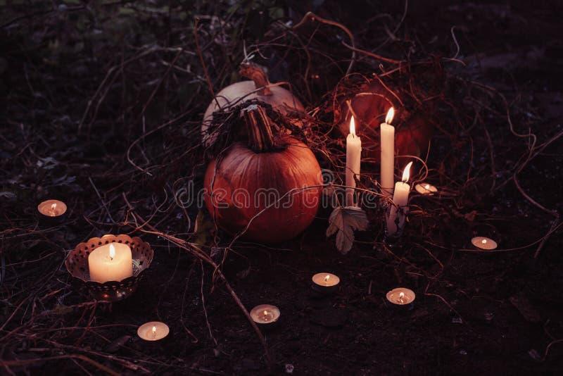 Jack O Lantern Beside Candles Halloween Decor stock photo