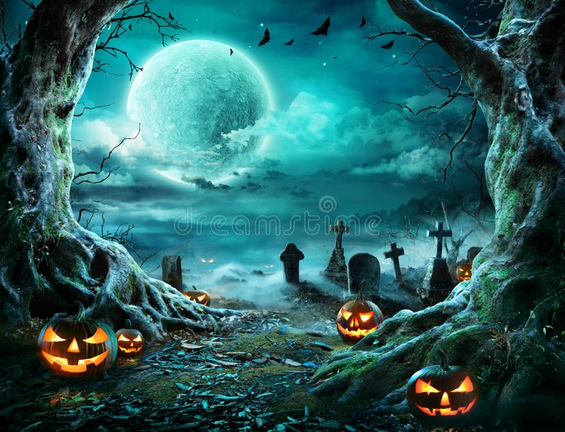 Jack `O Lantern In Cemetery In Spooky Night. With Full Moon - Halloween royalty free stock image