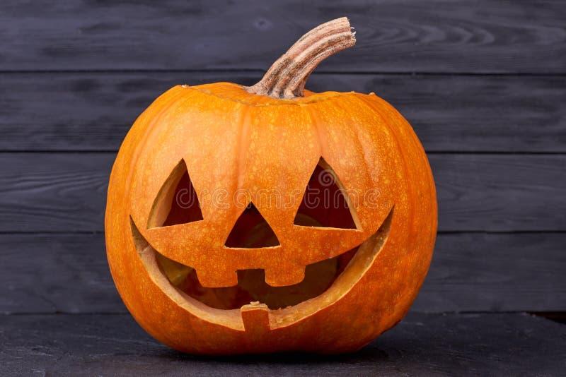 Jack O Lantern decoration. Halloween pumpkin on dark background. Easy pumpkin carving ideas for Halloween stock photos