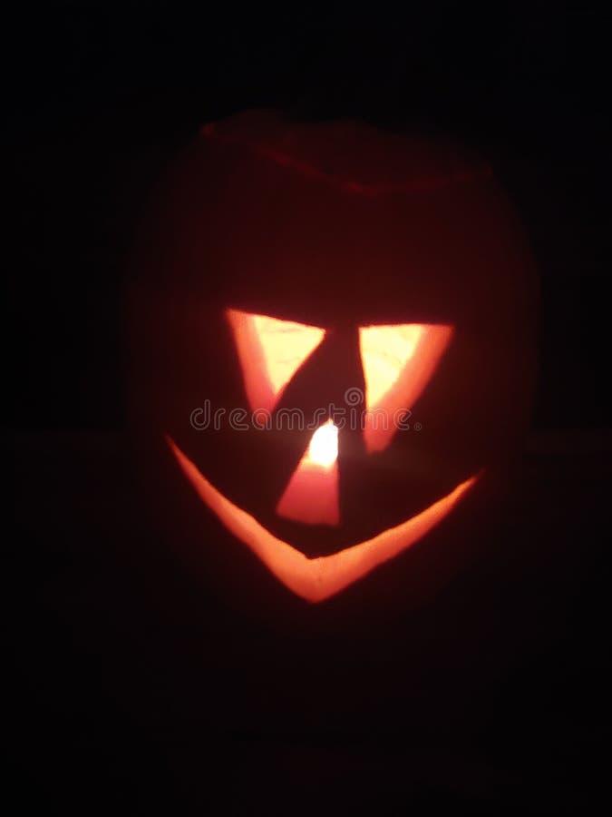 Jack-o-lantern Halloween orange pumpkin with scary face royalty free stock photo