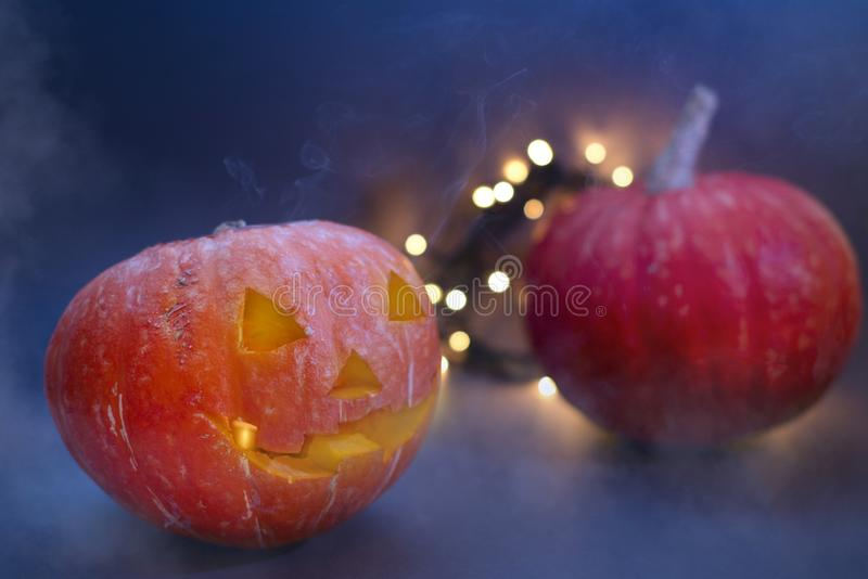 Jack O Lantern Halloween pumpkins, burning candles. Symbol of halloween royalty free stock photography