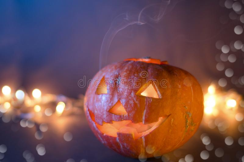 Jack O Lantern Halloween pumpkins, burning candles. Symbol of halloween stock photo