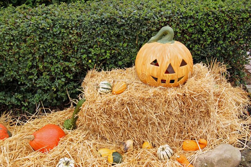 Jack-o'-lantern on Hay Stack during Day stock images