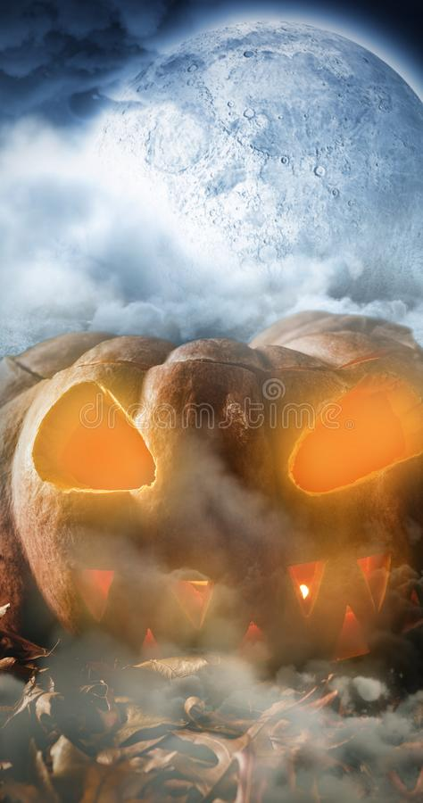 Composite image of jack o lantern with leaves on table. Jack o lantern with leaves on table against landscape of lakefront hiding the moon stock images