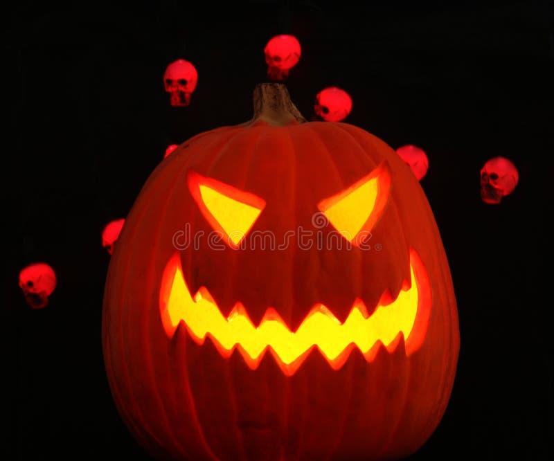 Download A Jack-o-lantern Plus Skulls Royalty Free Stock Photography - Image: 6690107