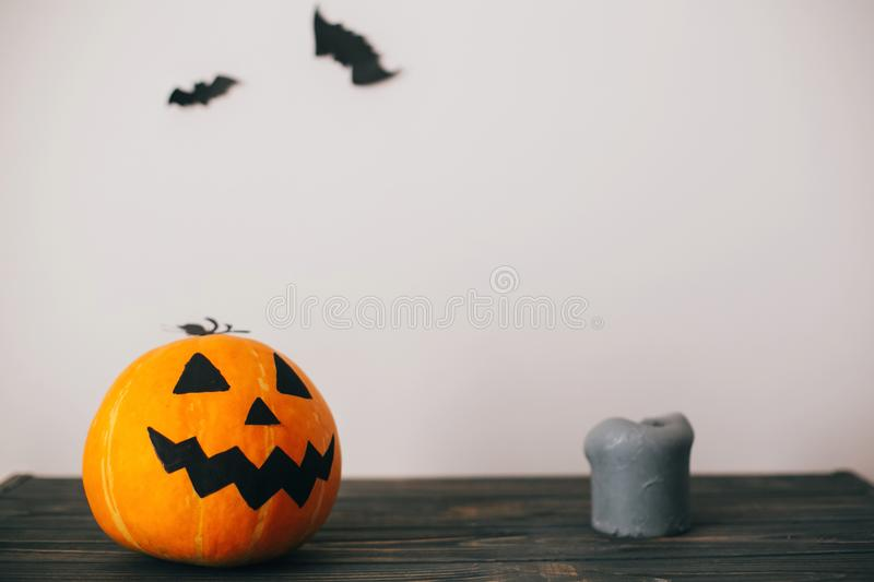 Jack o lantern pumpkin with candles and bats ghosts on spooky b. Ackground. atmospheric image. fall halloween photo . Happy Halloween concept stock images
