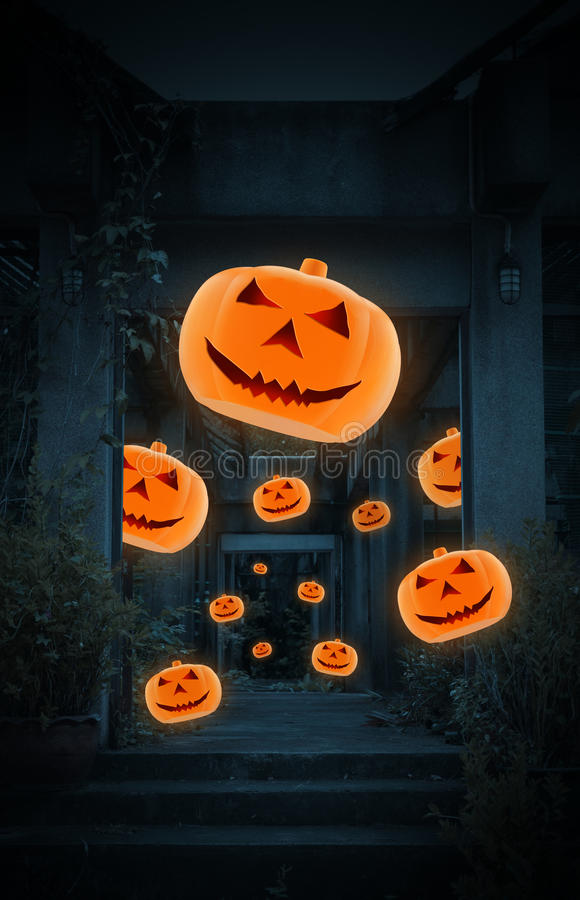 Jack O Lantern pumpkin fly over old damaged building royalty free stock image