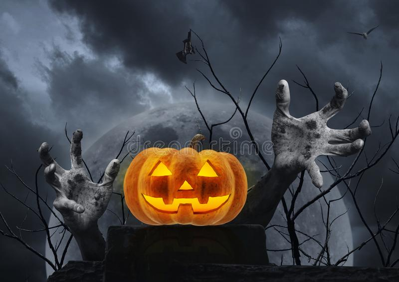 Jack O Lantern pumpkin on old ruin wall with zombie hand stock images