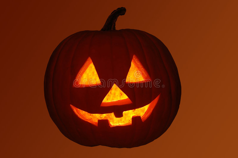 Jack-O-Lantern Pumpkin with Orange Background royalty free stock images