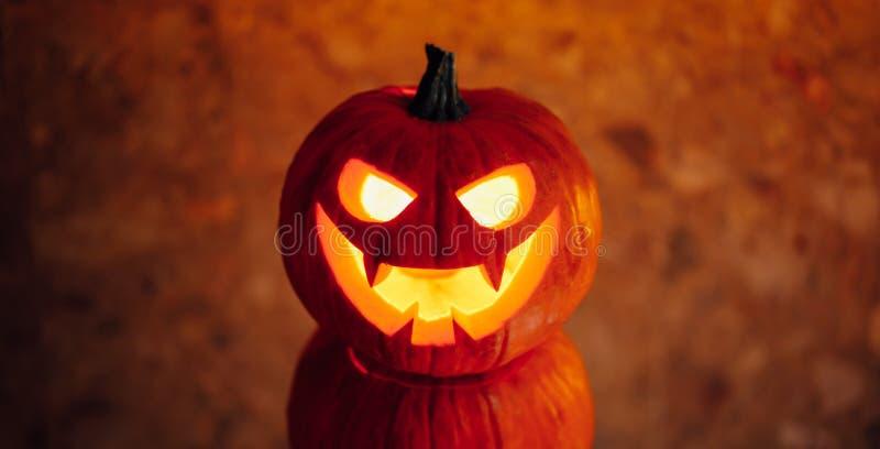 Jack-o-lantern pumpkin orange light, Halloween background. Close-up view stock photography