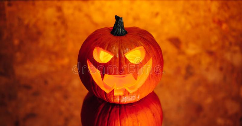Jack-o-lantern pumpkin orange light, Halloween background royalty free stock photo