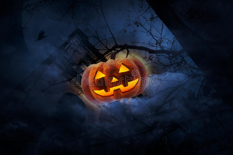 Jack O Lantern pumpkin over old fence, grunge castle, dead tree, bird fly, moon and cloudy sky, Spooky background, Halloween. Concept stock photography