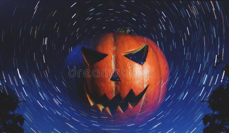 Jack-o ` - lantern on starry background,. With a scary pumpkin for Halloween stock image