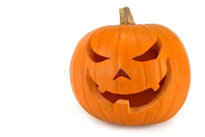 Jack-o'-lantern on white. Spooky Jack-o-lantern with evil lopsided grin on white background stock photography