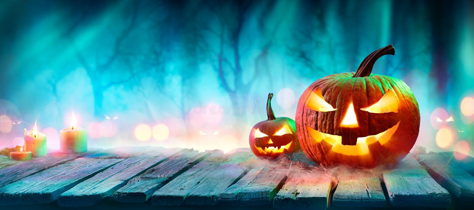 Jack O' Lanterns In Spooky Forest With Ghost Lights. Jack O' Lanterns In Spooky Forest With Ghost Lights - Halloween Background royalty free stock photos