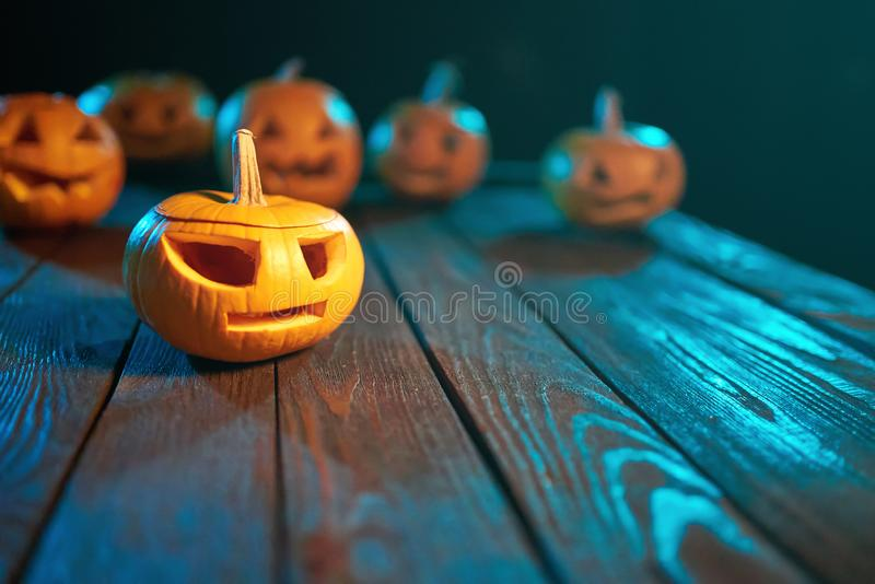 Jack-o-latern Halloween pumpkins on wooden planks background stock images