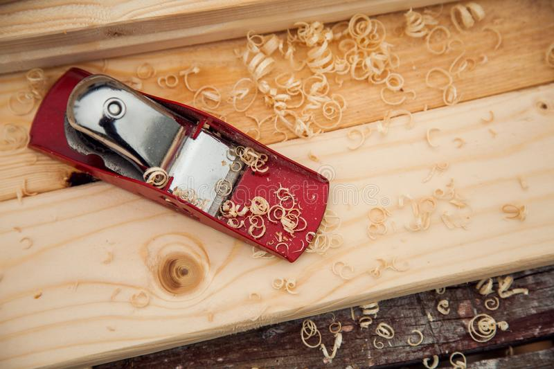 Jack-plane on wood chips boards on a workbench stock photography