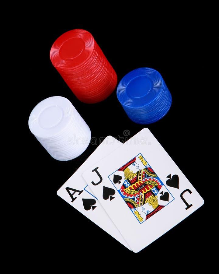 Jack preto com microplaquetas de póquer fotografia de stock