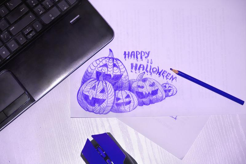 Jack pumpkin sketch, pencil, mouse and laptop are on the desk royalty free stock photos