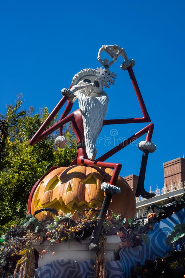 Jack Skellington Haunted Mansion Halloween Disneyland. Jack Skellington animated character sits outside Disneyland Haunted Mansion. Dressed in Santa suit for a stock image