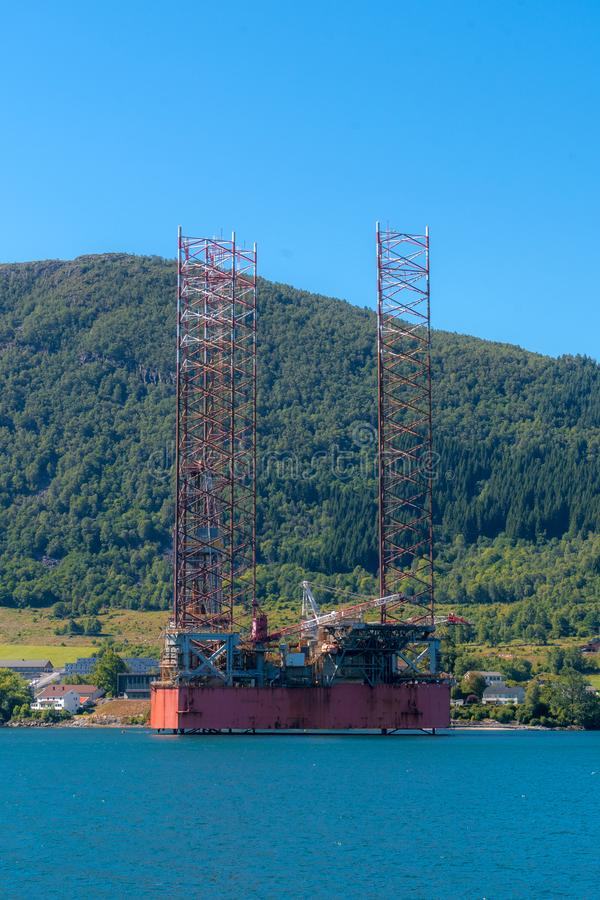 Jack up rig cold stacked in the Norwegian fjord waters stock photography