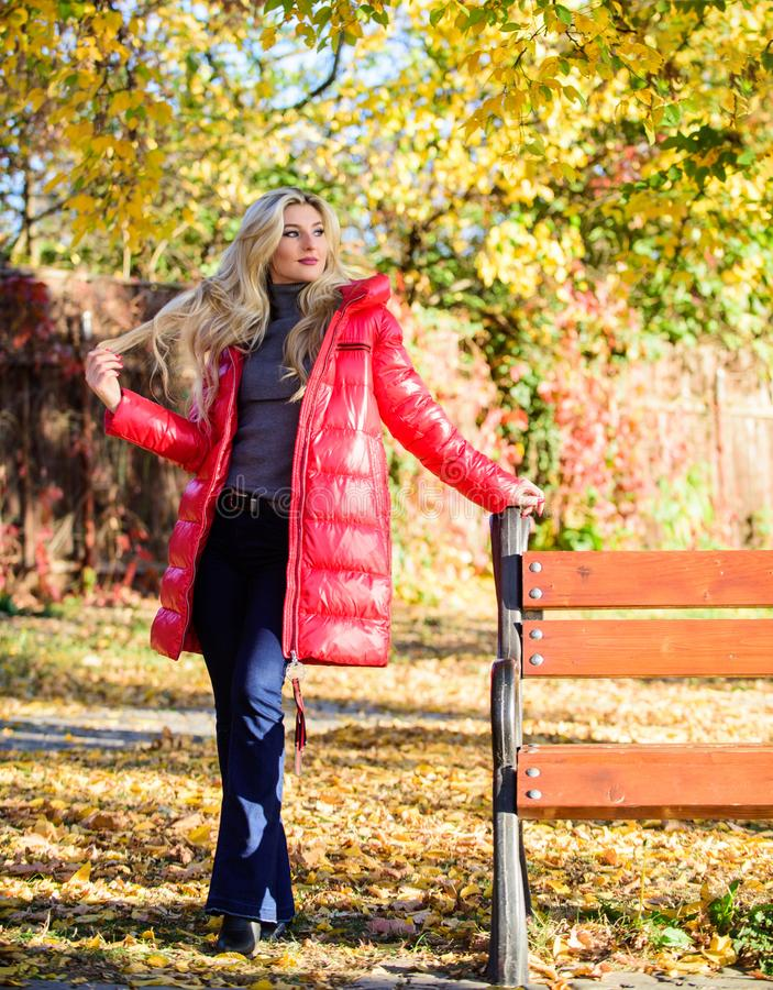 Jacket for fall season concept. Girl wear red bright warm jacket. Fall fashion concept. Lady attractive fashionista royalty free stock image