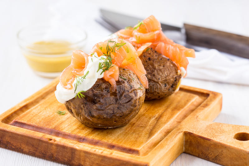 Jacket potatoes with soft cheese and smoked salmon royalty free stock photo