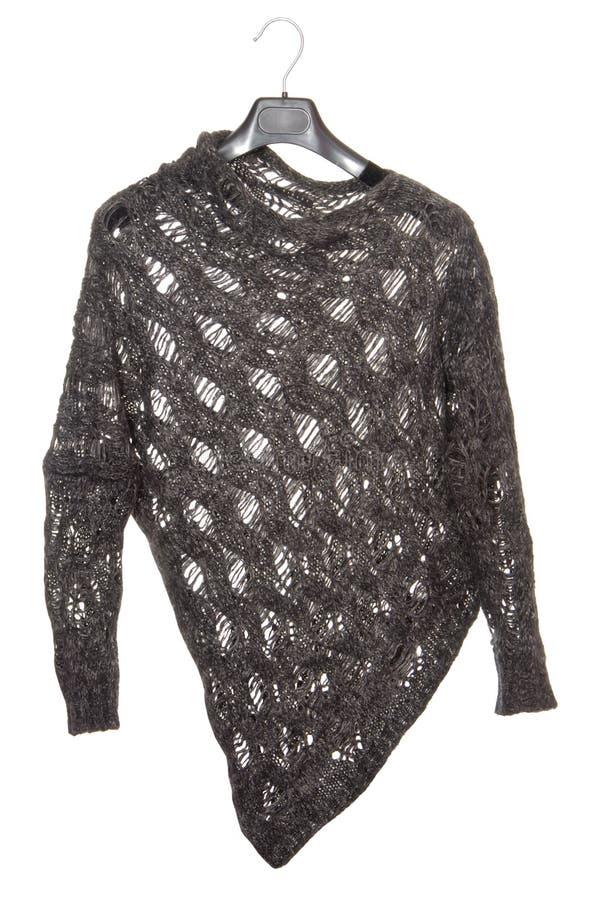 Jacket is on white, female black sweater, asymmetrical jumper, royalty free stock photo