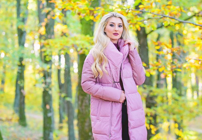 Jackets everyone should have. Girl fashionable blonde walk in park. Best puffer coats to buy. How to rock puffer jacket. Like star. Puffer fashion concept stock images