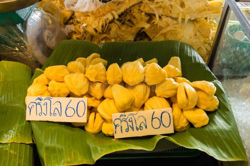 Jackfruit in marke Thailand, The price tag in Thai language mean. S & x22;Jackfruit half a kilo of 60 baht& x22 stock photo