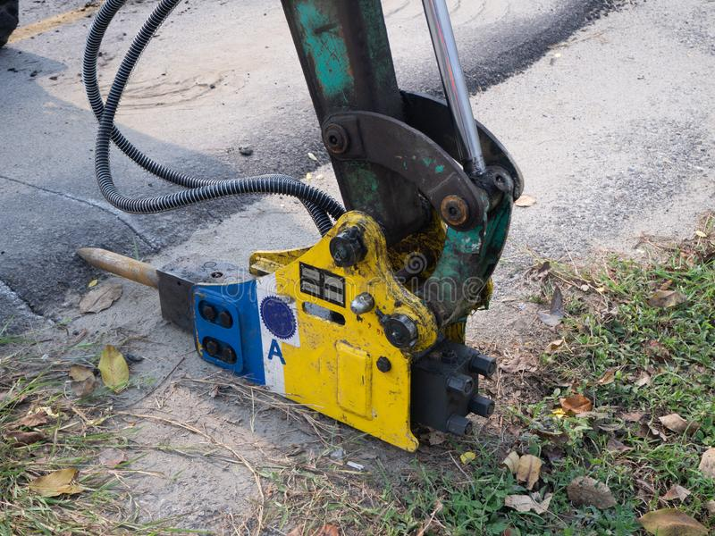 Jackhammer and drilling machine on construction site royalty free stock photography