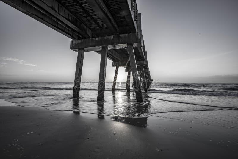 JACKSONVILLE BEACH FISHING PIER SUNRISE royalty free stock photography