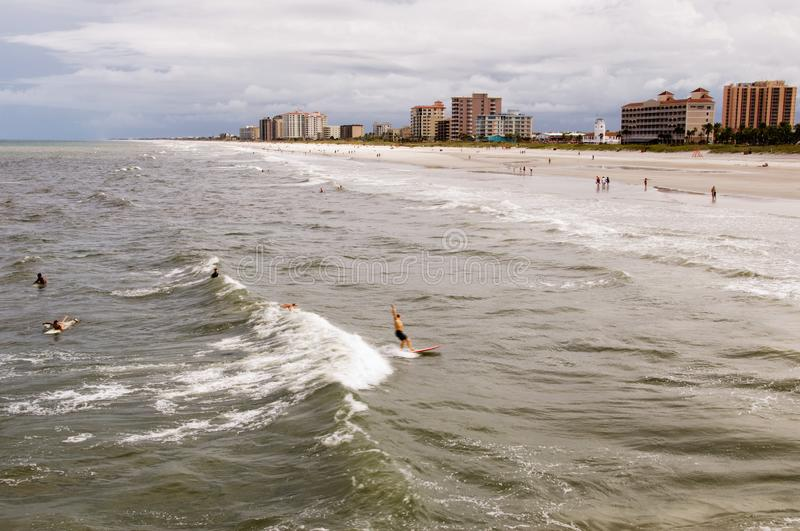 People Enjoying the Atlantic Ocean at Jacksonville Beach Florida USA stock images