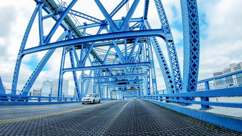 JACKSONVILLE, FL - APRIL 8, 2018: Main Street Bridge as seen fro. M a moving car. The city is a major attraction in Florida royalty free stock image