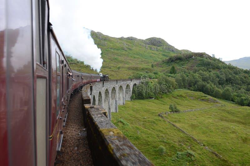 Jacobite steam train crossing Glenfinnan viaduct. stock photos